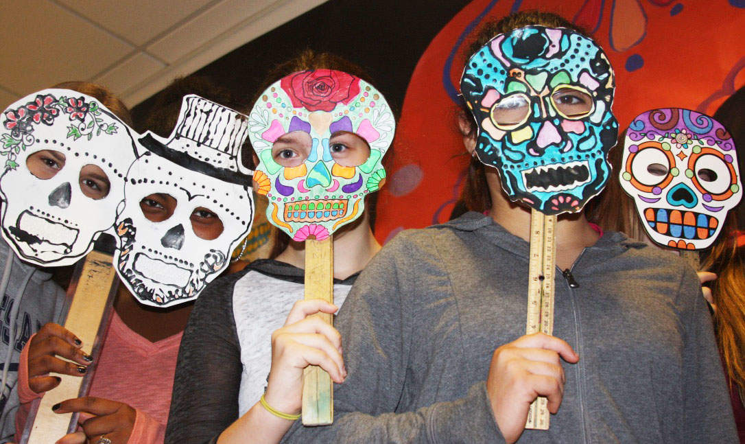 Middle School Students Celebrate Day Of The Dead With Colorful Art Projects
